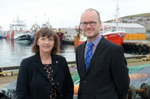 Sandra Lawrenson, CEO of Lerwick Port Authority besides David Nicolson of Bank of Scotland, who provided the funding