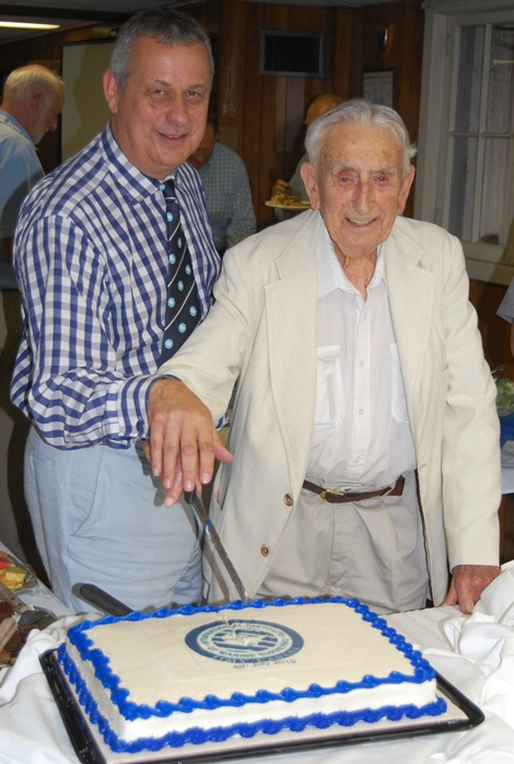 Capt. Lampshire-Jones and Mike Schwarz cut the specially prepared cake