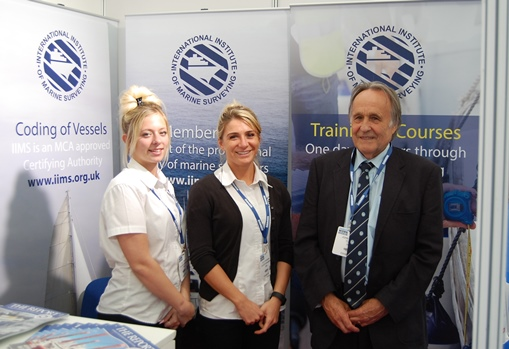 Elly Bryant and Elle Hardham join John Kilhams on  the IIMS stand