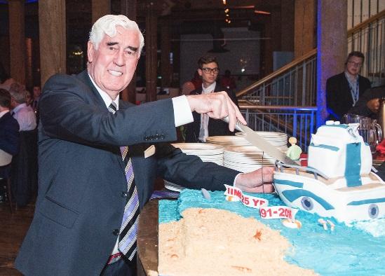 Capt Bill cuts the anniversary cake