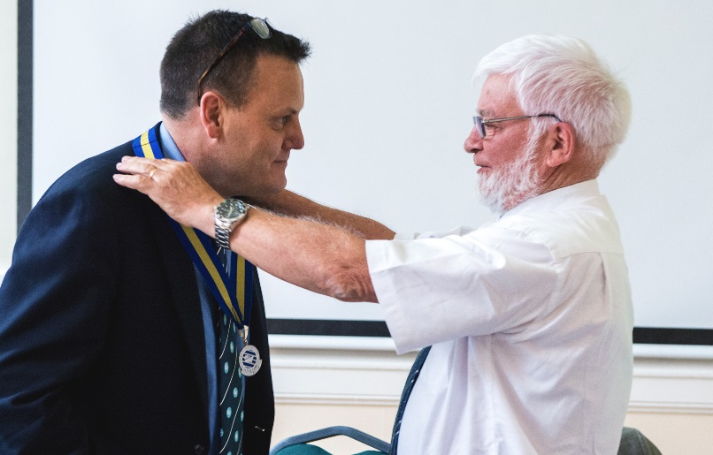 Capt Bertrand Apperry hands the President's medal over to Adam Brancher at the AGM. Photo by Kirk Schwarz - www.kirkschwarz.co.uk