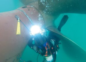 Diver/technician re-welding the rope guard after shaft seal replacement