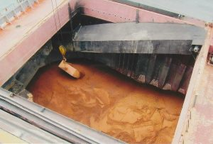 """Solid bulk cargoes are typically """"two-phase"""" materials as they contain water between the solid particles."""