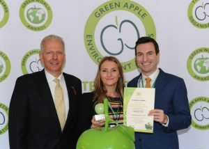 Michael Bennet (l) from PGT Reclaimed Vietnam presents the Green Apple Award to Plaswood's Katherine Lorek-Wallace and Hubbub's Adam Robinson Photo: The Green Organisation