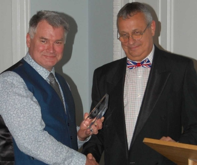 Mark Ford (pictured left) is presented with his Blue Water Award by Mike Schwarz