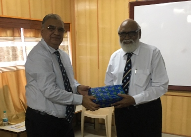 Capt. Mukesh Gautama presents a gift of appreciation to Tony Fernandez