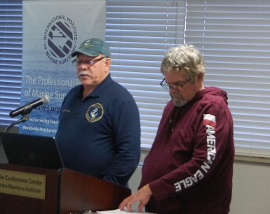 Capt Bill Weyant and Bob Kissinger discussing surveyor ethics