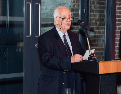 Captain Barry Thompson addressing dinner guests at the IIMS 25th Anniversary dinner in London in 2016