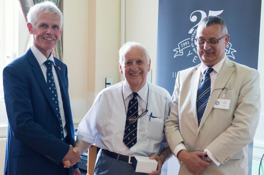 Captain Barry Thompson (centre) flanked by Sir Alan Massey (left) and Mike Schwarz (right) being presented with his Award for Excellence