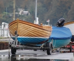 Small wooden boat on its trailer