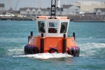 Small workboat being put through its paces