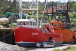 Pair of small trawlers laid up waiting for high tide