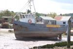 Old fishing vessel beached in north Norfolk