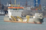 Small ship assisting the dredging operation off Portsmouth