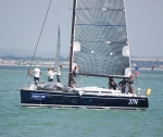Close up of this yacht as it sails by the beach at Cowes