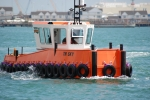 Small work boat being put through its paces