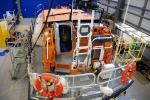 Looking down into one of the lifeboats in for repair