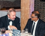 Guest speaker, Peter Hancock, chats earnestly with Milind Tambe