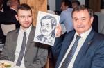 Capt Sergey Batmanov proudly holds aloft his caricature