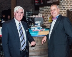 Capt Bill MacDonald (left) with Mike Schwarz and the anniversary cake