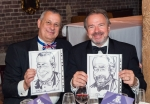 Mike Schwarz (left) and Peter Hancock show off their caricatures