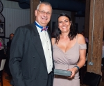 Mike Schwarz presents Vicky Lawrence with a gift to recognise her long service with IIMS