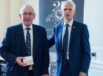 Chris Moody receiving his award from Sir Alan Massey