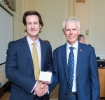 James Harrison (left) receiving his Award from Sir Alan