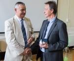 Mike Schwarz (left) congratulates Mike Andrews
