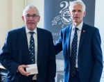 A humbled Chris Moody (left) with his award presented by Sir Alan Massey
