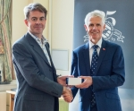 Nic Fieldhouse (left) proudly receives his award from Sir Alan Massey
