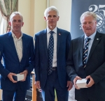 Richard Nicolson (left - on behalf of his father) and Paul Home (right) accept their awards from Sir Alan Massey