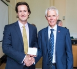 Sir Alan Massey (right) presents an award to James Harrison, co-founder of Sky-Futures Ltd