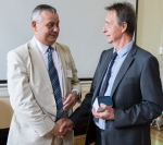Mike Schwarz (left) congratulates Mike Andrews on his award
