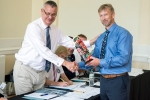 Capt Andrew Korek (right) presents a gift to Mike Schwarz from the IIMS Canada Branch