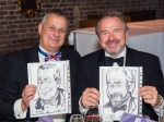 Mike Schwarz (left) and Peter Hancock proudly displaying their caricatures
