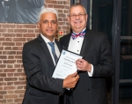 Uday Moorthi (left) being presented with his Honorary Membership Certificate by Mike Schwarz